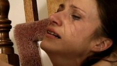 Muscly Dominatrix Takes It Out On A Suggestive Brunette At Home